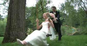 Bride on a swing, with groom